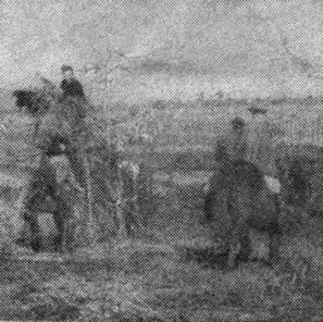 Algunos campesinos echan paja sobre el lodo del camino a Barrancas para volverlo transitable